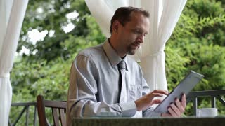 Man working at home from balcony