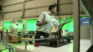 Man Working Inside Indian Factory