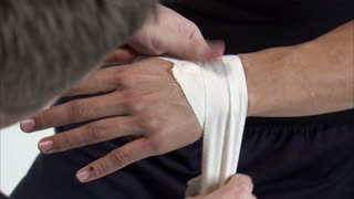 Mans Hands Getting Taped and Ready for Boxing