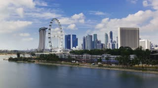 Marian Bay and the Singapore Flyer viewed towards the central city skyline, South East Asia, Time lapse