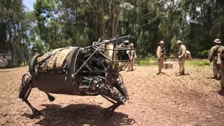 Marine LS3 robot patrols with Marines