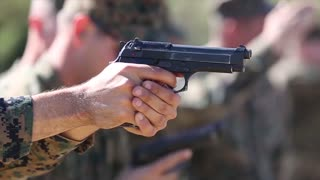 Marines  qualify with the pistol through the new Combat Pistol Program