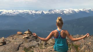 Meditating On Canadian Mountain Top