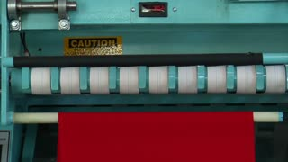 Medium Close-up Of Industrial Ironing Machine And Red Cloth