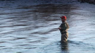 Medium Shot  Of Man Flyfishing In River In Wintertime