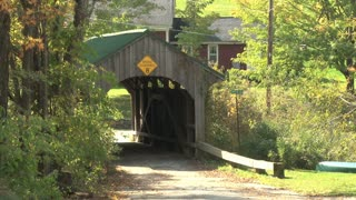 Medium Wide Shot Of Covered Bridge