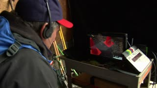 Member Of Film Crew Watches Scene On Monitor