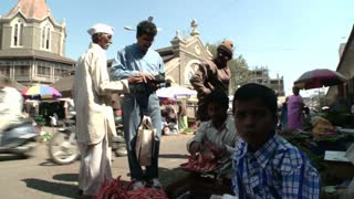 Men Buying Goods at Market