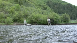 Men Flyfishing in Flowing River