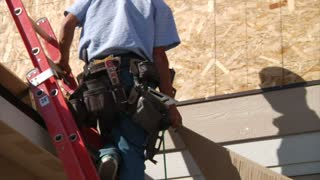 Men In Tool Belt Installs Wood
