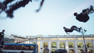Men  Jump Over His Head On The City Street