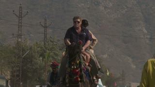 Men on Camel Ride in Rajasthan India
