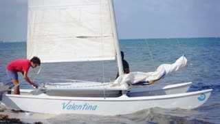 Men prepare to sail on catamaran