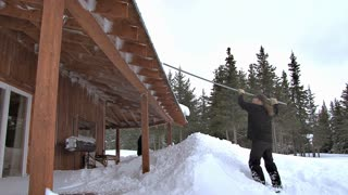 Men Raking Snow off Roof and Deck After Blizzard