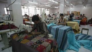 Men working in garment factory sewing at machines, Sari garment factory, Rajasthan, India, Asia, MR