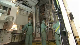 Men Working in Space Center