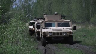 Military Police Company Humvee fire their guns