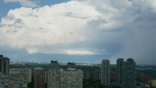 Mississauga Clouds and Toronto Timelapse. Time Lapse of urban residential buildings in downtown Mississauga, Canada. Shot during a sunny summer day with clouds.
