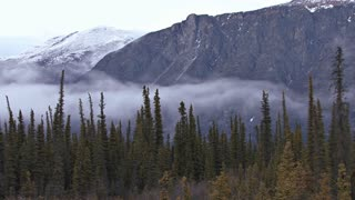 Misty Clouds Sweep Into Mountain Range