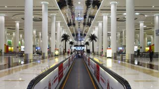 Modern building and moving walkway with passengers, Dubai International Airport, Dubai, UAE, T/Lapse