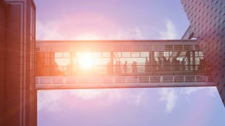 modern futuristic architecture. group team together. people walking. sun flare