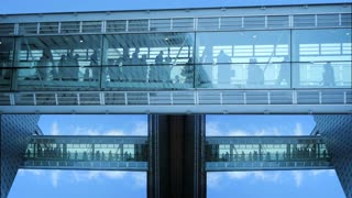 modern futuristic glass hallway tower. group team together. business people