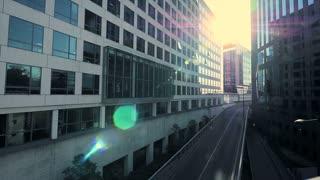 modern office building. sun beaming. sunbeam. sun flare. urban city district
