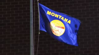 Montana Flag Waving Gently In The Breeze