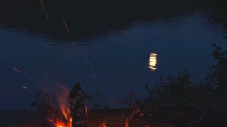 Moon Reflection On Lake By Campfire