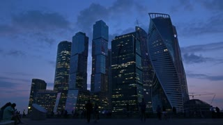 Moscow city business district skyscrapers and tourists at late evening. 4K shot