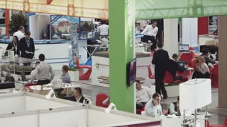 MOSCOW, RUSSIA - APRIL 11, 2014: Busy customers and agents on international estate event DOMEXPO at Gostiny Dvor