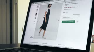 MOSCOW, RUSSIA - FEBRUARY, 6, 2017. Timelapse of browsing through pages of popular online fashion store asos. com. Online shopping. 4K video
