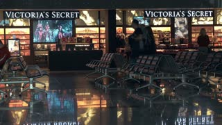 MOSCOW, RUSSIA - FEBRUARY 8, 2015: Dolly shot of duty free area with empty seats and Victorias Secret store in Vnukovo Airport