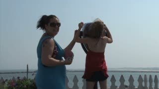 Mother and Daughter Looking into Tourist Telescope 2