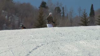 Mother And Kid-son Skiiers Enjoy The Slopes