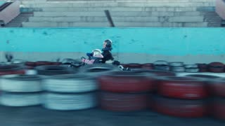 Mother and little daughter rides on karting