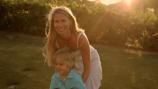 mother and son twirling in sunset