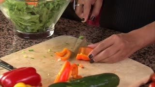 Mother Cutting Vegetables for Salad 2