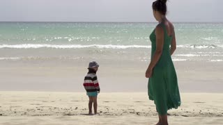 Mother with his son on the beach, slow motion shot at 240fps