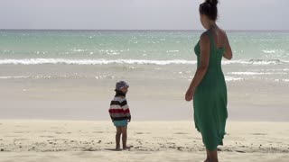 Mother with his son on the beach, slow motion shot at 60fps