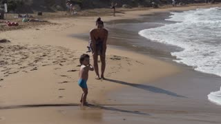 Mother with his son running on the beach, slow motion shot at 240fps
