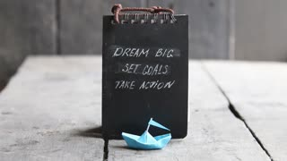 Motivational Quote. Dream big, set goals, take action on blackboard written. Vintage style.