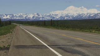 Motorcycle Speeding Down Parks Highway in Alaska
