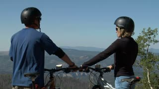 Mountain Biking Couple Pause For View