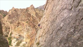 Mountain Climber Jumping Across Face of the Mountain 14