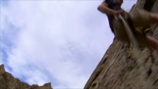 Mountain Climber Repelling Down a Cliff Face 3