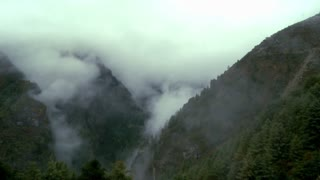 Mountains Shrouded in Mist and Clouds