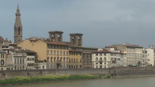 Multi-Colored Buildings Along Bank of the Arno