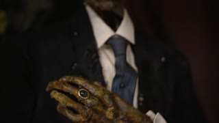 Mummified Man In Suit Horror Imagery
