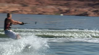 Muscular Man Jumps  Wake On Wake Board